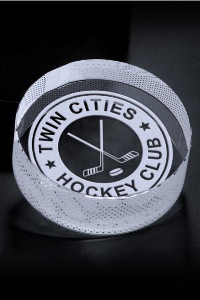 Glass hockey puck